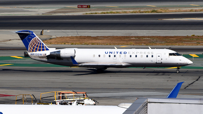 A picture of N915SW - Mitsubishi CRJ200LR - United Airlines - © Rocky Wang
