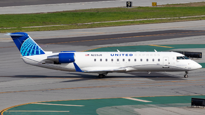 A picture of N223JS - Mitsubishi CRJ200ER - United Airlines - © Chris Phan