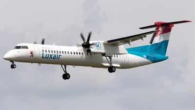 A picture of LXLQA - De Havilland Canada Dash 8400 - Luxair - © G.Cruchten