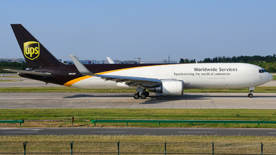 A picture of N323UP - Boeing 76734AF(ER) - UPS Airlines - © songxiuming