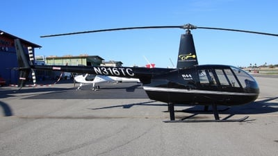 A picture of N316TC - Robinson R44 Raven II - [12303] - © ian simpson