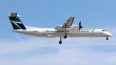 A picture of CGWEJ - De Havilland Canada Dash 8400 - WestJet - © Guy Langlois