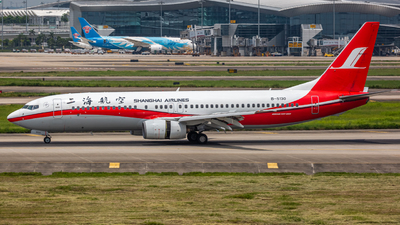 A picture of B5130 - Boeing 7378Q8 - Shanghai Airlines - © Henry Chan