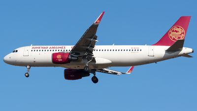 A picture of B8235 - Airbus A320214 - Juneyao Airlines - © BobH