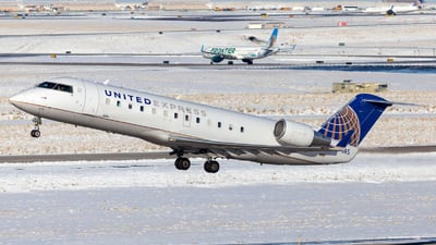 A picture of N876AS - Mitsubishi CRJ200LR - United Airlines - © HA-KLS
