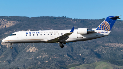 A picture of N869AS - Mitsubishi CRJ200LR - United Airlines - © Ricky Teteris