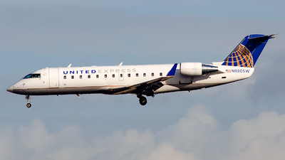 A picture of N980SW - Mitsubishi CRJ200LR - United Airlines - © James Rowson