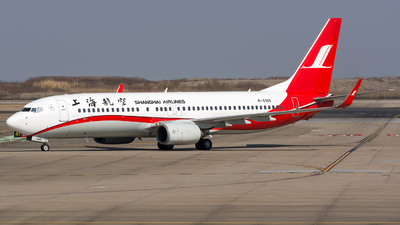 A picture of B5185 - Boeing 7378Q8 - Shanghai Airlines - © BobH