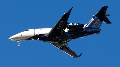 A picture of VHVKX - Embraer Phenom 300 - [50500316] - © Brandon Giacomin