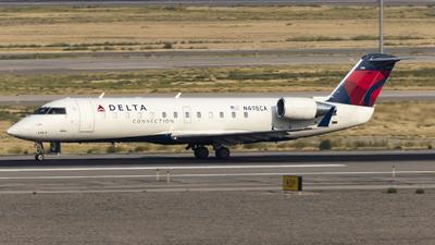 A picture of N498CA - Mitsubishi CRJ200LR - Delta Air Lines - © David Lee