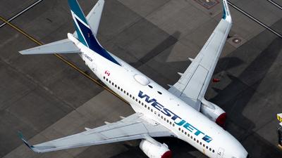 A picture of CGWCM - Boeing 7377CT - WestJet - © Derek MacPherson