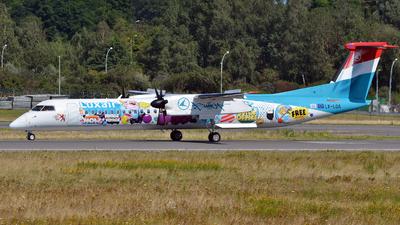 A picture of LXLQA - De Havilland Canada Dash 8400 - Luxair - © Volker Hilpert