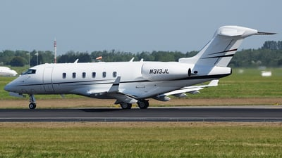 A picture of N313JL - Bombardier Challenger 300 - Delta Private Jets - © John Fitzpatrick