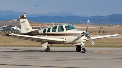 A picture of CGDMJ - Beech A36TC Bonanza - [EA238] - © Mike MacKinnon