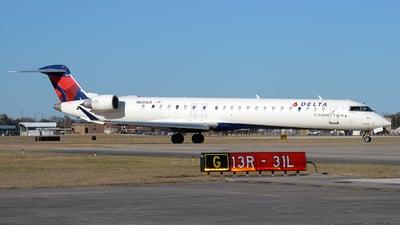 A picture of N605LR - Mitsubishi CRJ900LR - Delta Air Lines - © Javier Vera