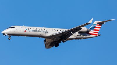 A picture of N543EA - Mitsubishi CRJ702ER - American Airlines - © Martin Pinnau