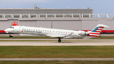 A picture of N584NN - Mitsubishi CRJ900LR - American Airlines - © Guy Langlois