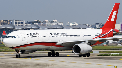 A picture of B6097 - Airbus A330343 - Shanghai Airlines - © Mr.Huang