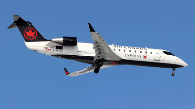 A picture of CGJZZ - Mitsubishi CRJ200ER - Air Canada - © Guy Langlois