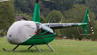 A picture of PHKTM - Robinson R44 Raven II - [11078] - © Julian S.