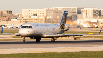 A picture of N454AW - Mitsubishi CRJ200LR - United Airlines - © Ben Suskind
