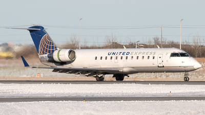 A picture of N963SW - Mitsubishi CRJ200ER - United Airlines - © Mike MacKinnon