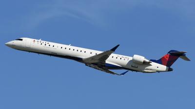 A picture of N678CA - Mitsubishi CRJ900LR - Delta Air Lines - © DJ Reed - OPShots Photo Team