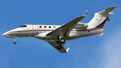A picture of N328QS - Embraer Phenom 300 - NetJets - © Kaz T