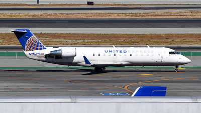 A picture of N986SW - Mitsubishi CRJ200LR - United Airlines - © Rocky Wang