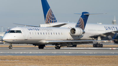 A picture of N423AW - Mitsubishi CRJ200LR - United Airlines - © Graham Wesbury