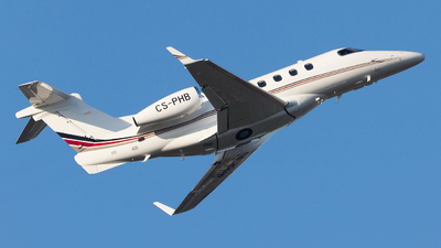 A picture of CSPHB - Embraer Phenom 300 - NetJets - © Holm H