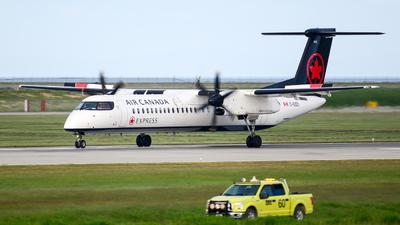 A picture of CGGCI - De Havilland Canada Dash 8400 - Air Canada - © Chung Kwok