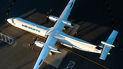 A picture of CFIWE - De Havilland Canada Dash 8400 - WestJet - © Derek MacPherson