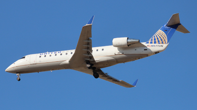 A picture of N971SW - Mitsubishi CRJ200LR - United Airlines - © Ethan Peters