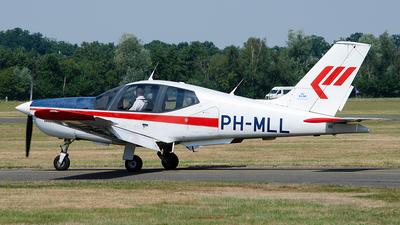A picture of PHMLL - Socata TB20 Trinidad - Martinair Holland - © Paul Stam