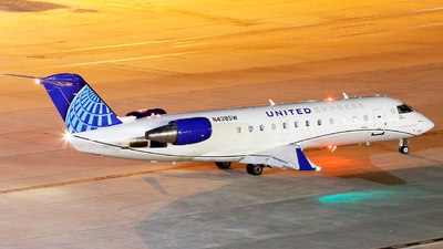 A picture of N438SW - Mitsubishi CRJ200LR - United Airlines - © Roger M