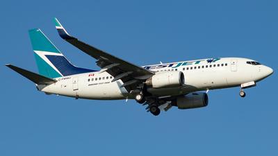 A picture of CFMWJ - Boeing 7377CT - WestJet - © Kevin Leinweber