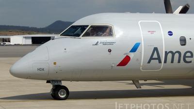 A picture of N333EN - De Havilland Canada Dash 8300 - [221] - © Mike Egan