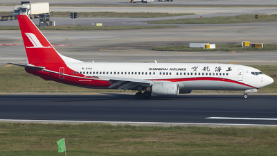 A picture of B5140 - Boeing 7378Q8 - Shanghai Airlines - © heitanyang
