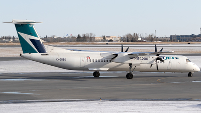 A picture of CGWEG - De Havilland Canada Dash 8400 - WestJet - © Mike MacKinnon